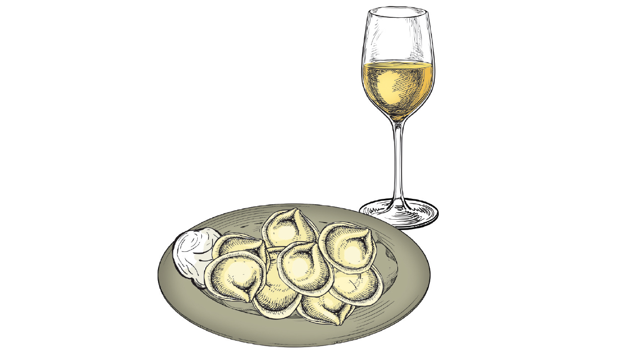 pel'meni with a glass of wine