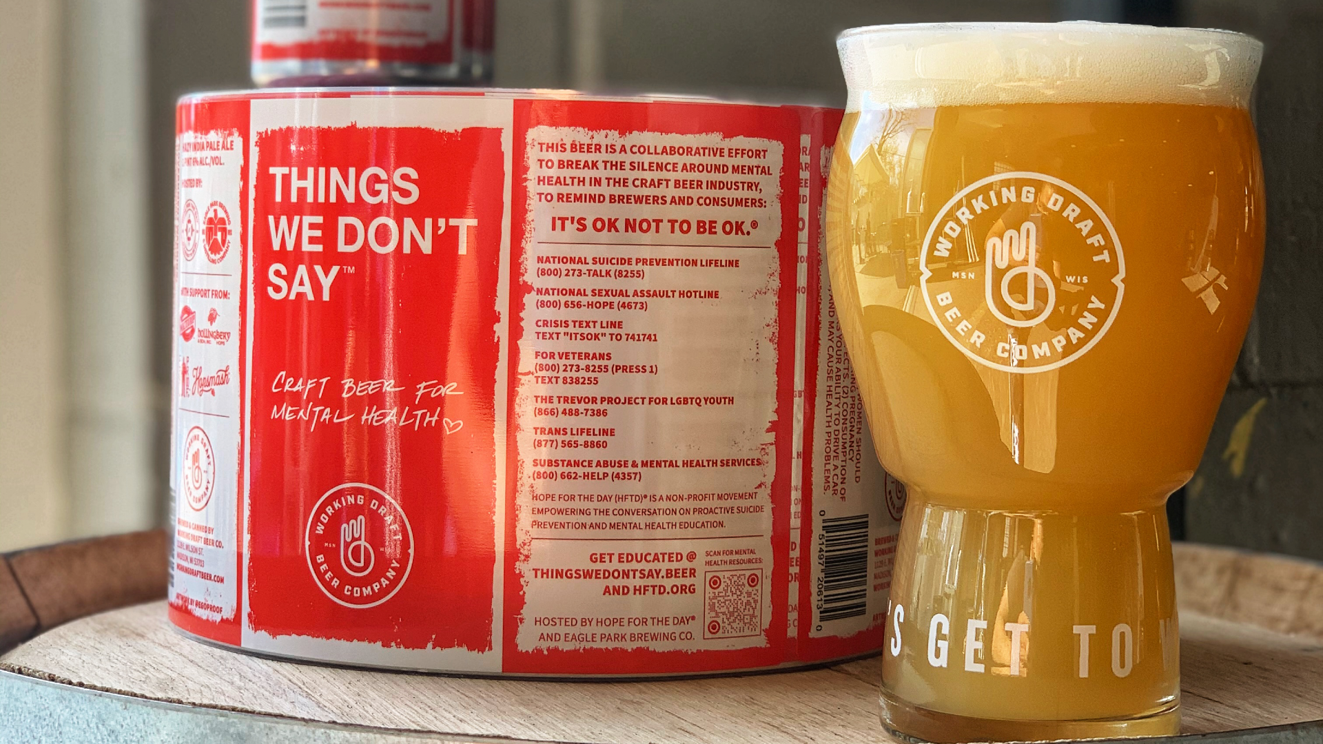 """Red and white labels for """"Things We Don't Say"""" next to a full glass of beer"""