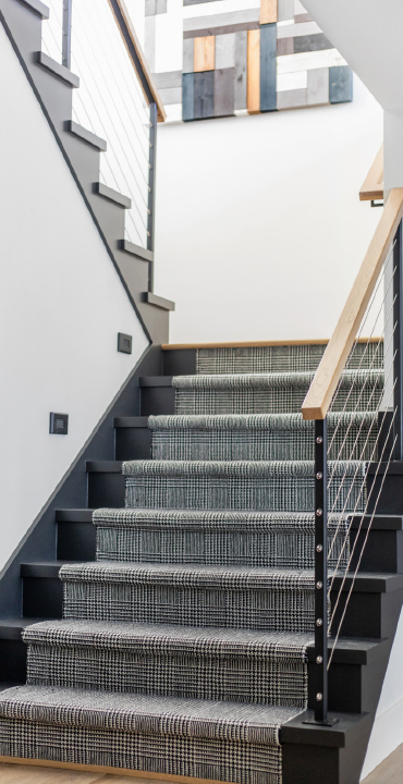 carpeted stairs going to another level of the home