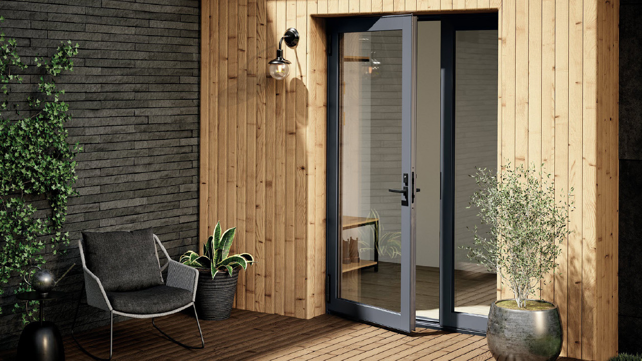 Exterior of house with clear glass doors opening to wooden deck and outdoor potted plants