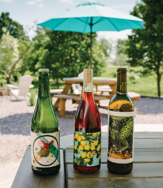 three bottles of wine on the patio of American Wine Project
