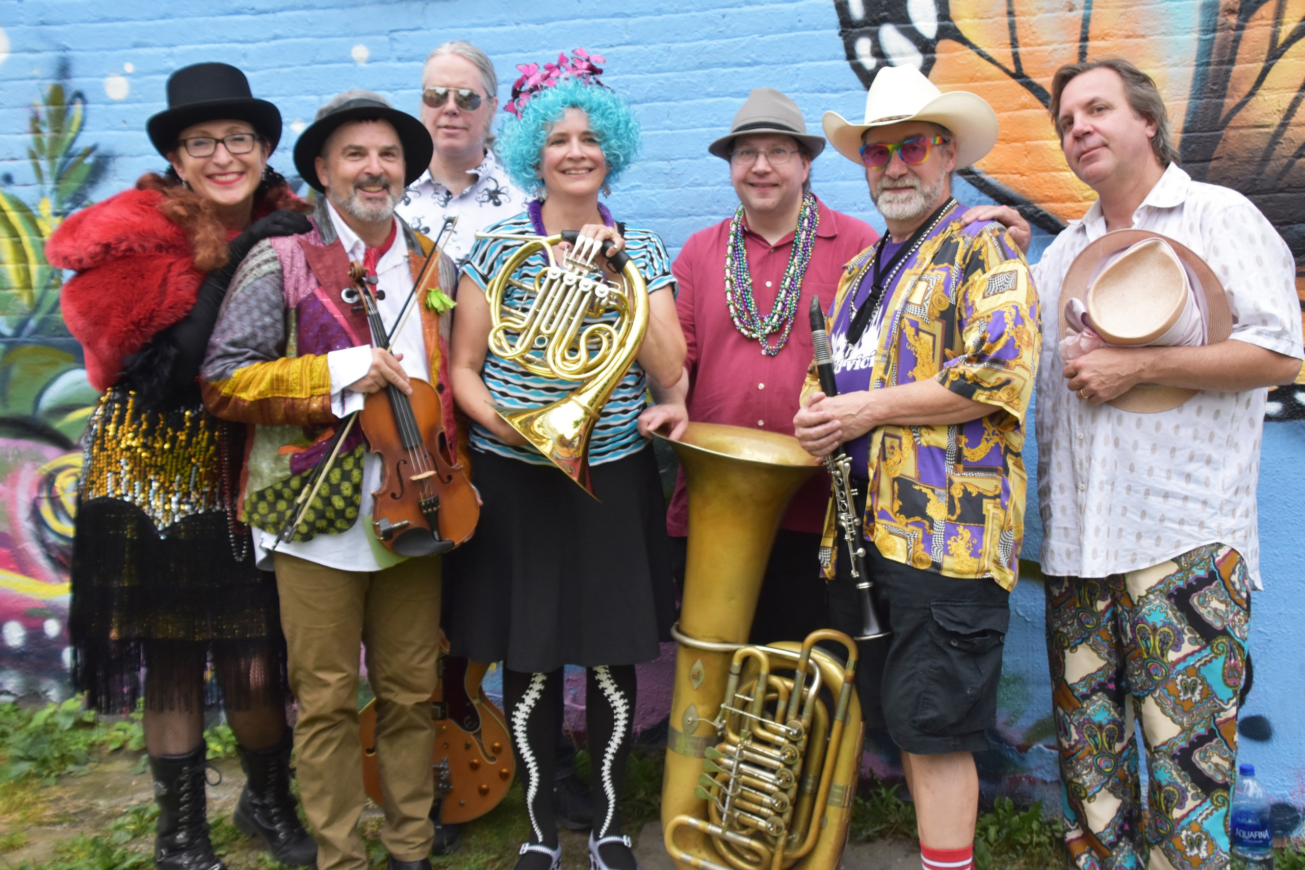 Several members of the klezmer band Yid Vicious, in costume with instruments