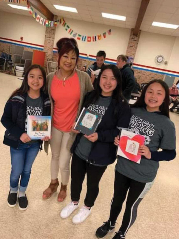 Pat with three students