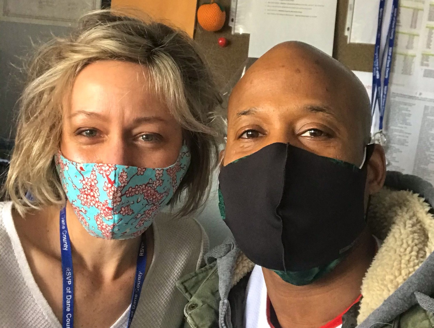 Kate Seal (left) and Yusef Wafford (right) wear their volunteer-crafted masks.