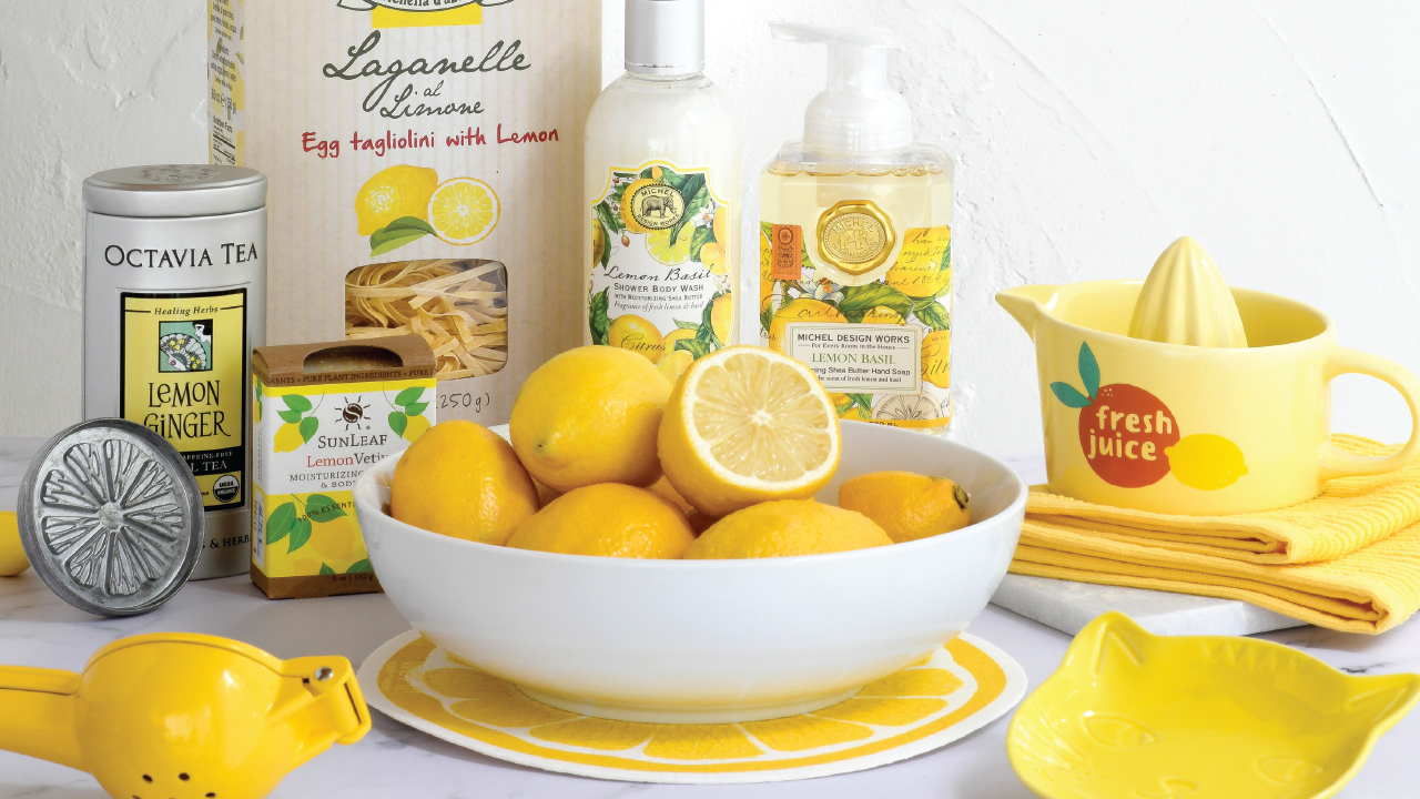 Spread of products from Orange Tree Imports with a bowl of lemons in the middle
