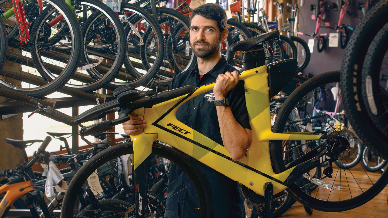 Ben Classon holding a yellow bicycle