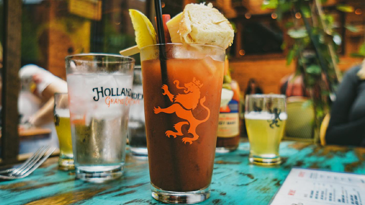 Bloody Mary on top of a table with other drinks around