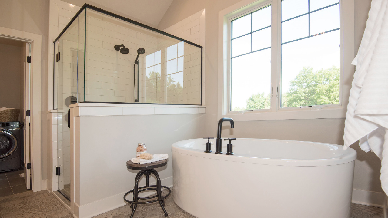 Bathroom interior with free standing bathtub and glass shower stall