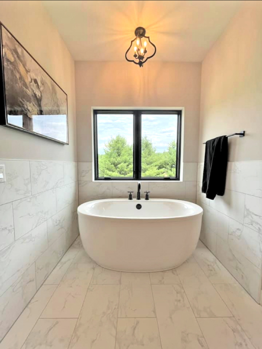 Bathroom Interior with freestanding tub in front of a window