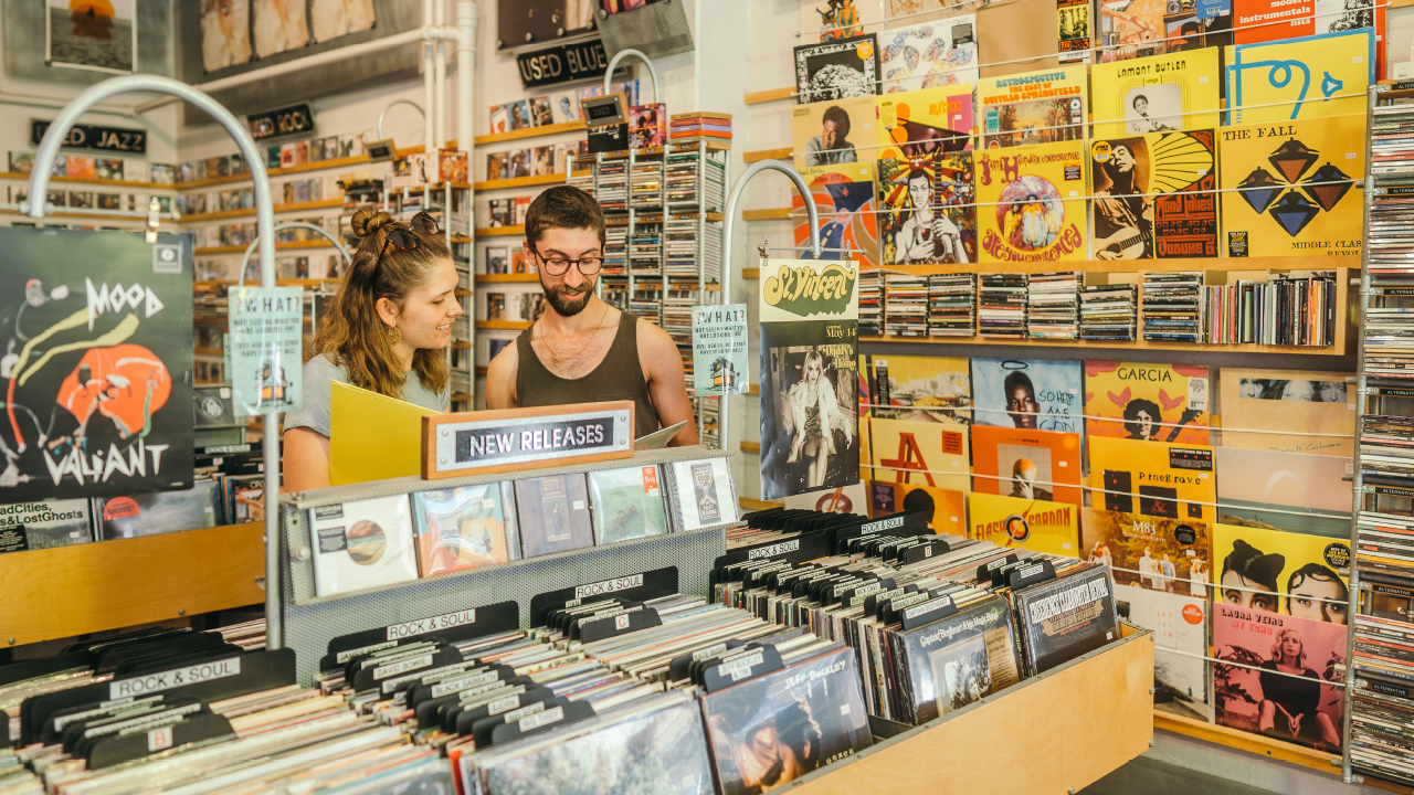 two people shopping in a record store