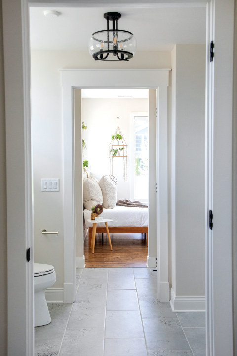looking out through the bathroom into the bedroom of a home