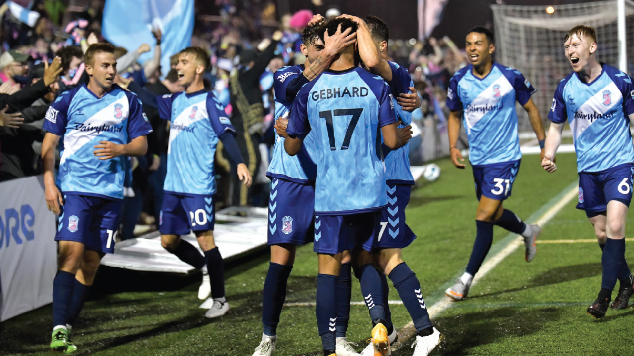 Forward Madison FC players jumping on the field after winning a game