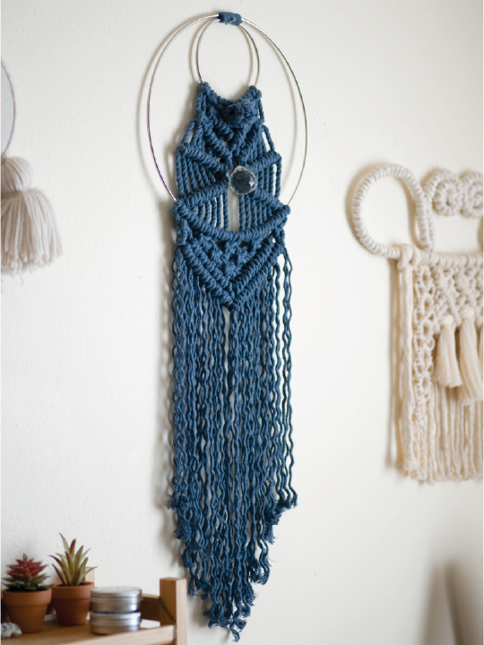 circular wall hanging with blue designs
