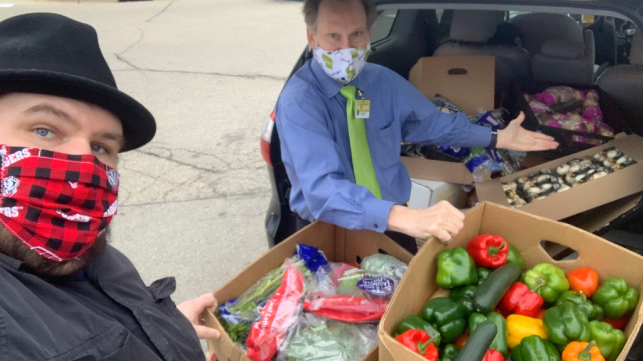 Chef Dave Heide and Kevin Metcalfe with produce at a car