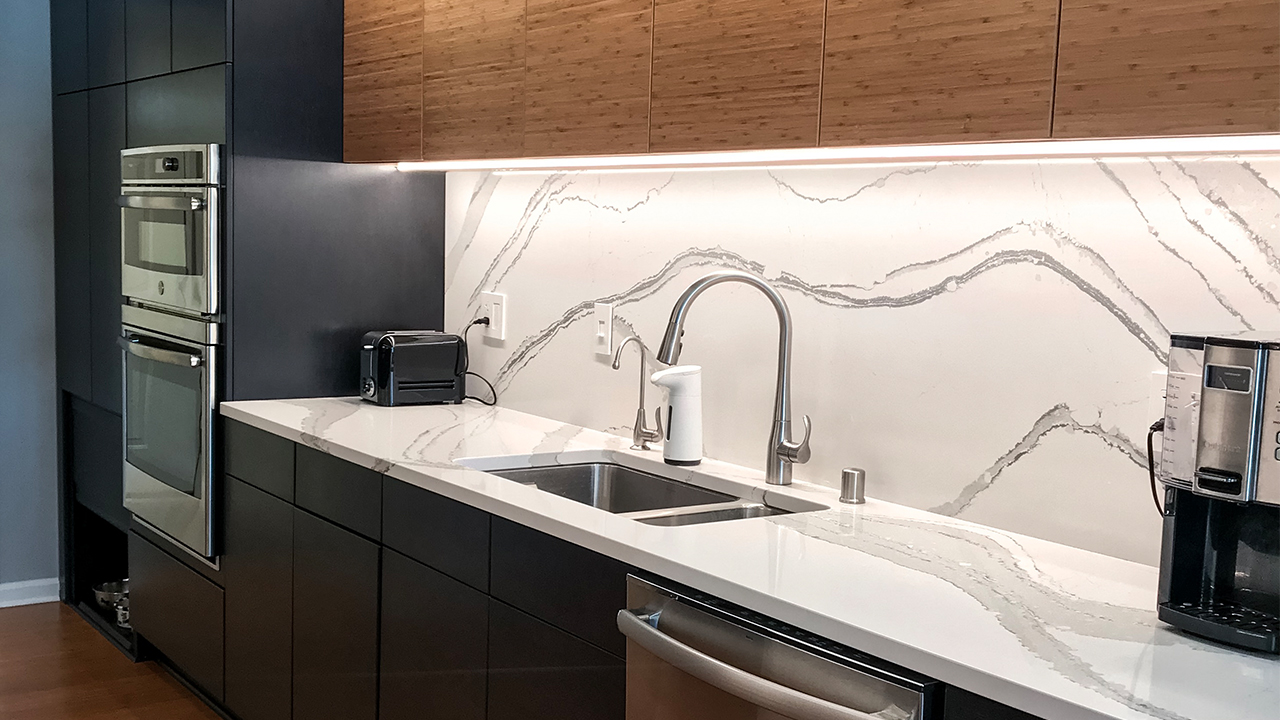 Modern Kitchen with white marble a wood cabinets