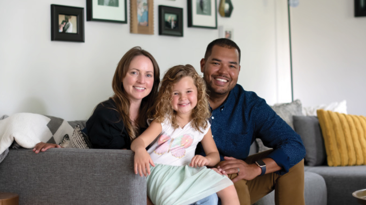 Matt and Abby with their daughter in their living room