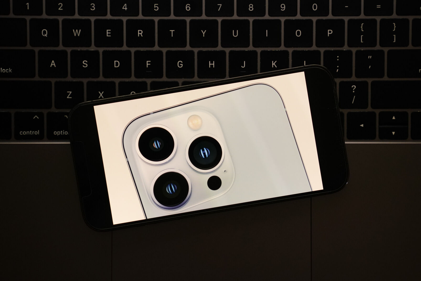 <p>A portion of the new iPhone 13 Pro smartphone is seen on a device display in La Habra, Calif., during its introduction in a virtual event held to announce new Apple products Tuesday, Sept. 14, 2021. (AP Photo/Jae C. Hong)</p>