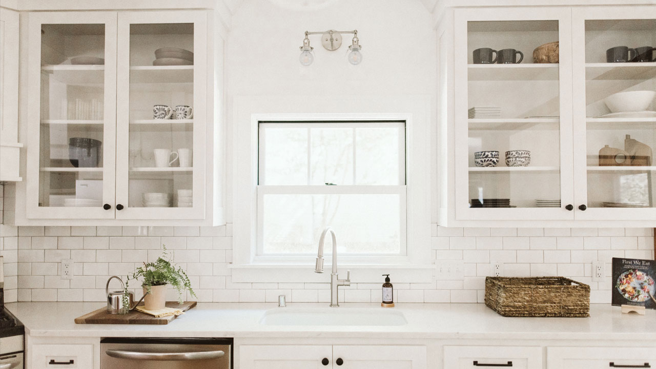 white kitchen space with cabinets