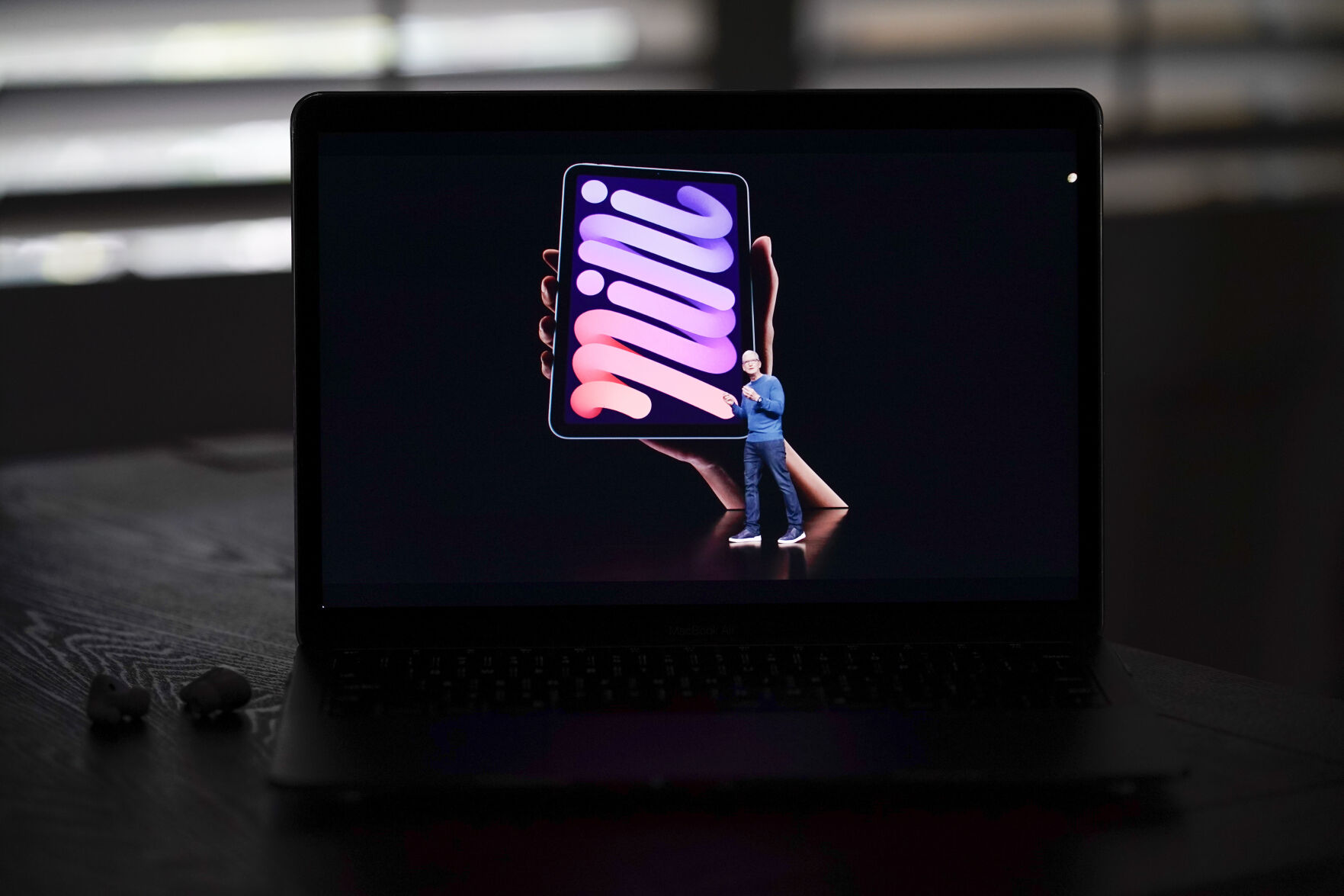 <p>Seen on the screen of a device in La Habra, Calif., Apple CEO Tim Cook introduces the new iPad mini during a virtual event held to announce new Apple products Tuesday, Sept. 14, 2021. (AP Photo/Jae C. Hong)</p>