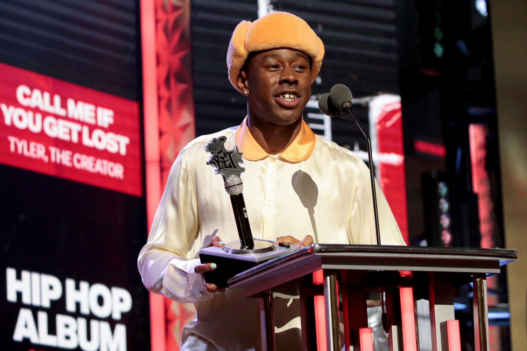 <p>Tyler, the Creator accepts the award for hip hop album of the year at the BET Awards.</p>