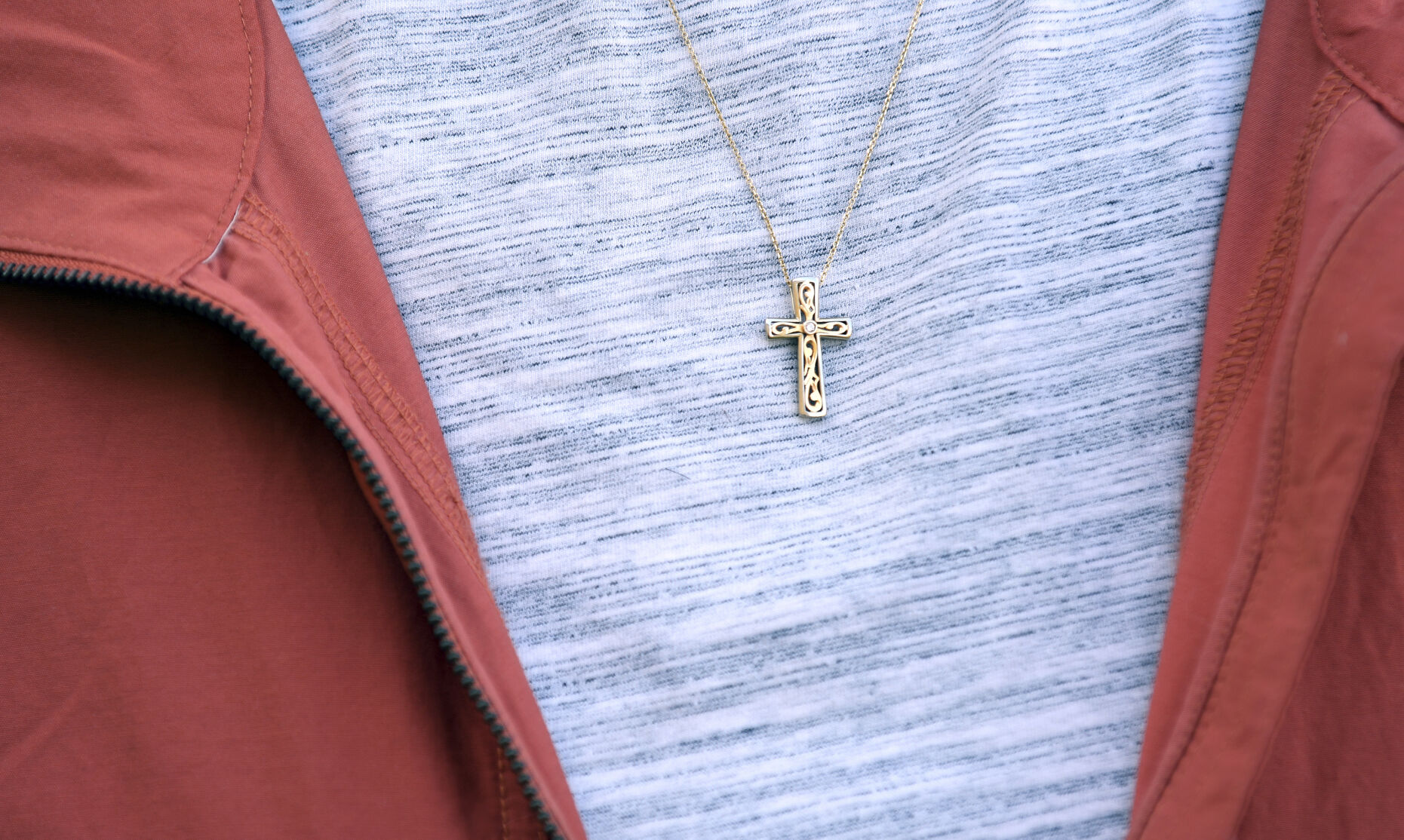 <p>Leilani Lutali wears a cross around her neck at her home in Colorado Springs, Colo.</p>